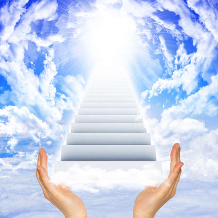 Hands hold stairs in sky with clouds and sun. Concept background photo