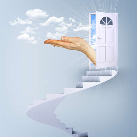 Spiral stairs and magic doors with hand leading to a cloudscape photo