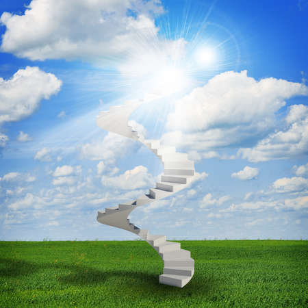 Spiral stairs in sky with green grass, clouds and sun photo