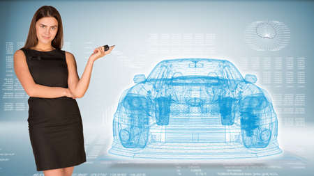 Businesswoman with key and wire frame car photo