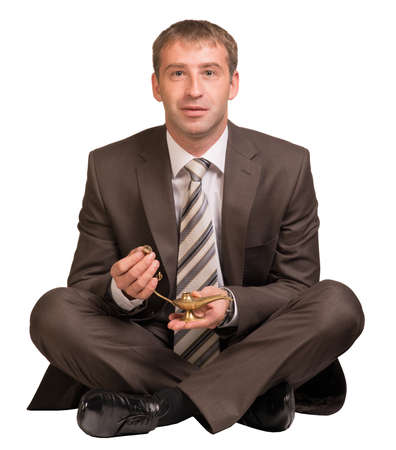 levitating: Businessman sitting and hold gold lamp