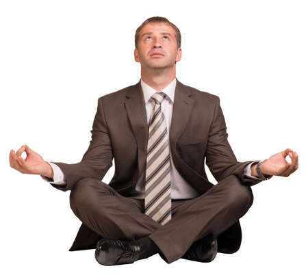 levitating: Businessman sitting in lotus position