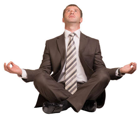 lotus position: Businessman sitting in lotus position