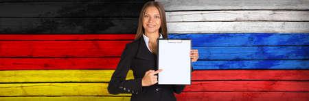foreign secretary: Businesswoman holding paper holder