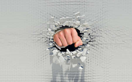 れんが造りの壁を通ってパンチ拳 写真素材