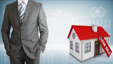 purchasing manager: Businessman with small house
