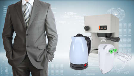electric tea kettle: Business man with coffee machine, kettle and blender Stock Photo
