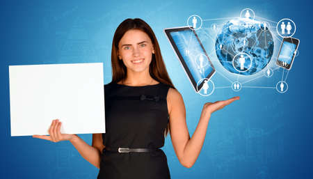 Businesswoman holding empty paper and Earth with electronics photo