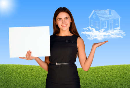 Businesswoman holding paper sheet and house of clouds photo