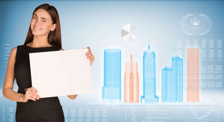 Businesswoman holding paper sheet photo