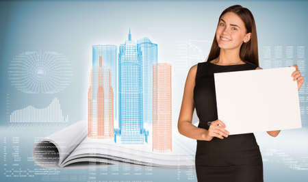 Businesswoman holding paper sheet photo