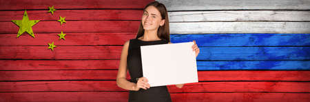 foreign secretary: Businesswoman holding paper sheet Stock Photo