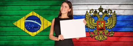 foreign secretary: Businesswoman holding paper sheet Stock Photo