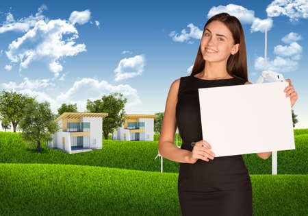 Businesswoman with landscape and houses photo