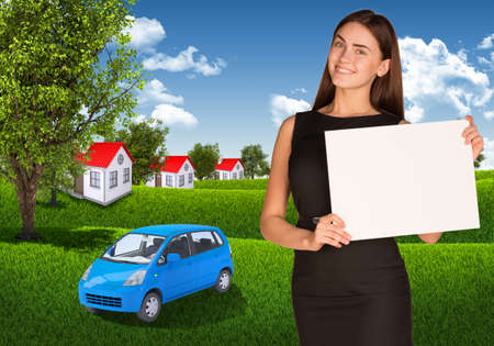 Businesswoman with car, landscape and houses photo