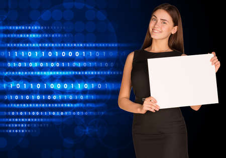 Businesswoman with glowing figures and circles photo