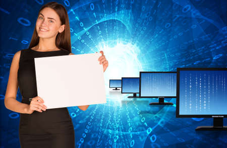 Businesswoman with rows monitors and glowing figures  photo