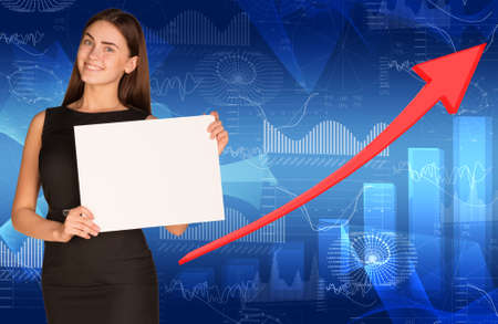 Businesswoman with arrow and graphs photo