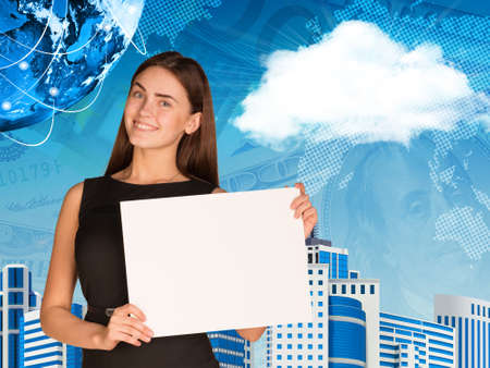 Businesswoman with cloud, Earth, skyscrapers and money photo