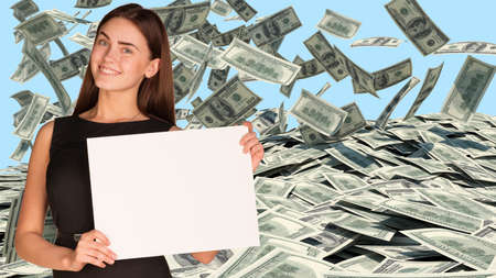 Businesswoman with dollars falling photo