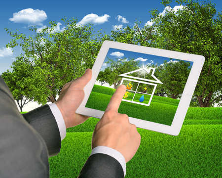 Man using tablet with symbols of public service and house photo