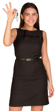 Businesswoman holding house keys photo