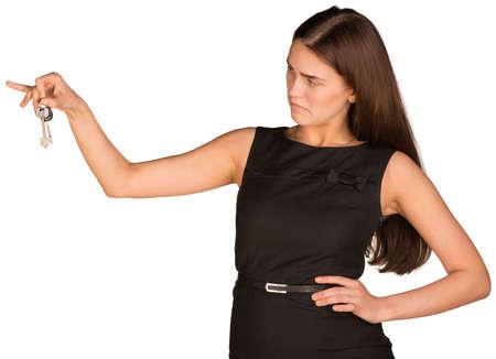 Businesswoman holding house key photo