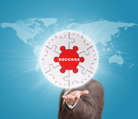Business man hold puzzle sphere with business label photo
