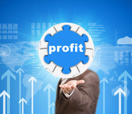 Business man hold puzzle sphere with profit label photo