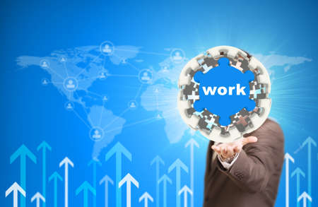 Business man hold puzzle sphere with Work label photo