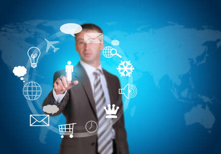 service sphere support web: Businessman in suit pointing her finger at cloud icons Stock Photo