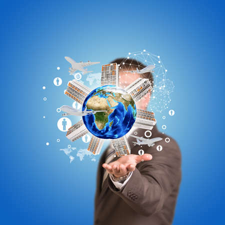plant stand: Business man hold Earth with buildings. Airplane and network icons Stock Photo