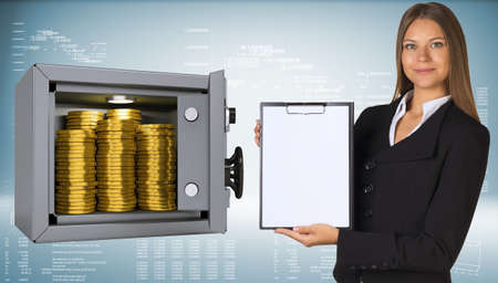 Businesswoman holding paper holder. Safe with gold coins photo