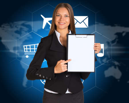 Businesswoman with cloud of icons and world map photo