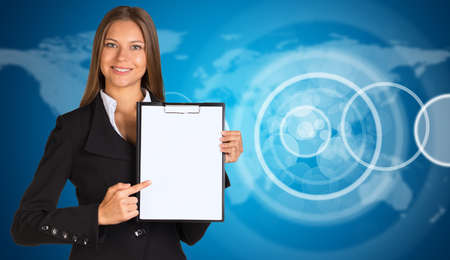Businesswoman with empty circle frames and world map photo