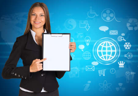 Businesswoman with cloud icons and world map  photo