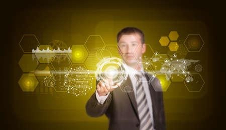 Businessman in suit finger presses virtual button photo