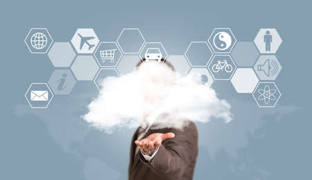 Businessman in suit hold cloud photo