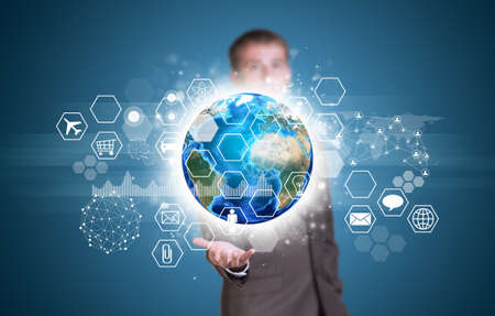 Businessman hold Earth with graphs, hexagons and network photo