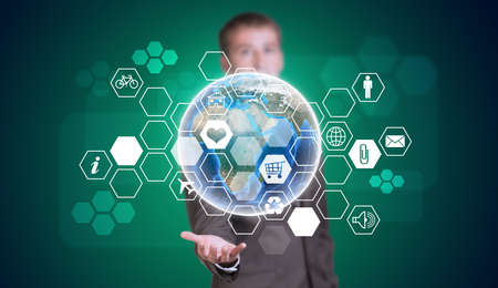 Businessman in suit hold Earth and hexagons with icons photo