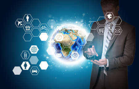 Man hold empty copy space. Earth and hexagons with icons photo