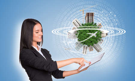 Women using digital tablet and Earth with buildings photo