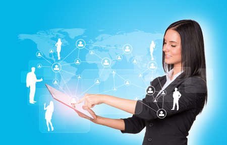 using tablet: Women using digital tablet and silhouettes of business people  Stock Photo