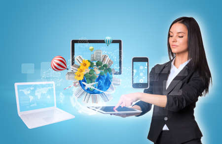 Women using digital tablet and Earth with electronics photo