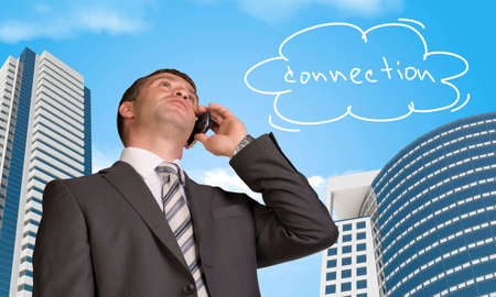 Businessman talking on the phone. Cloud with word connection photo