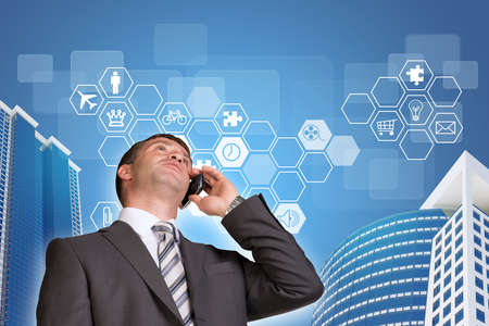 Businessman talking on the phone. Skyscrapers and hexagons with icons photo