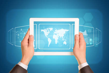 using tablet: Man hands using tablet pc. Image of world map on tablet screen