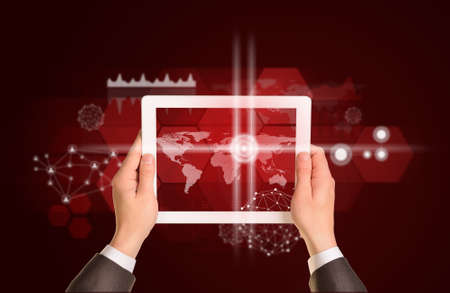 Man hands using tablet pc. Image of world map on tablet screen photo