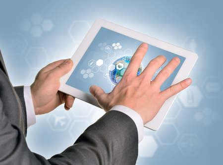 Man hands using tablet pc. Image of Earth on tablet screen. Element of this image furnished by NASA photo