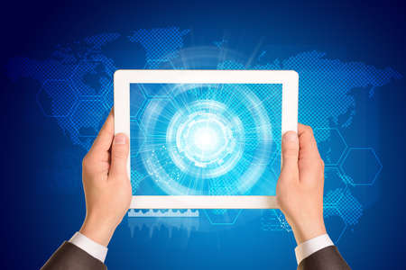 using tablet: Man hands using tablet pc. Image of business elements on tablet screen Stock Photo
